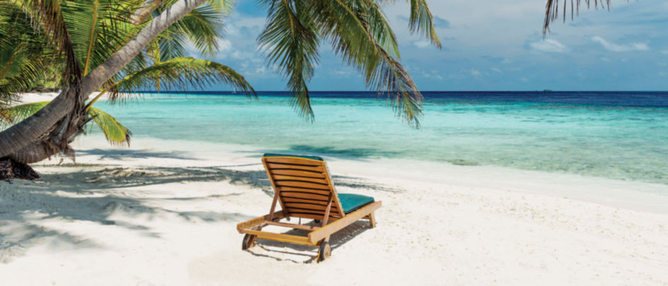 Beach chair in white sand in a tropical location