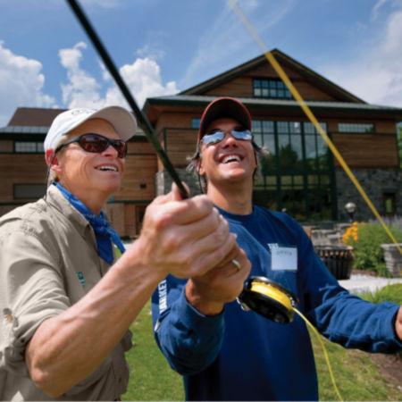 Man teaching a fly fishing cast