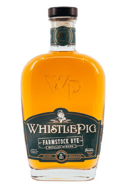 A bottle of whiskey with a green and gold label.