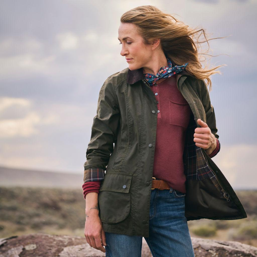 Jillian posing, showing the sweater under her jacket