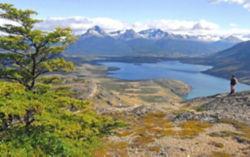 Hiker on mountain overlooking Patagonia