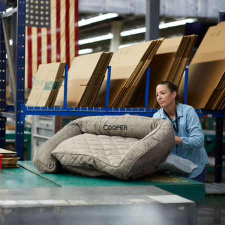 Woman working on the personalization of an Orvis Dog Bed