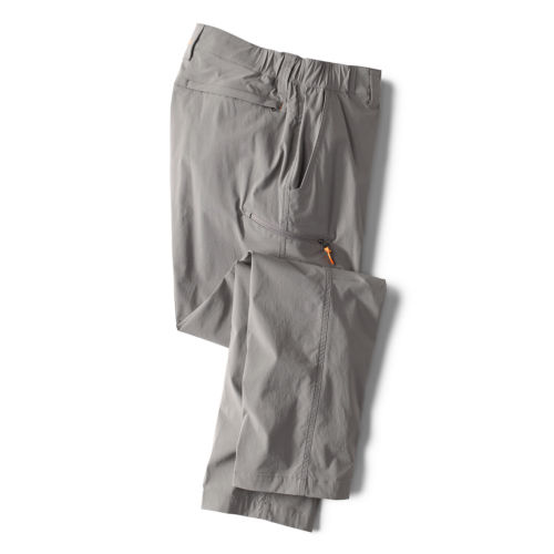 A pair of grey pants with a bright orange zip-pull on the side