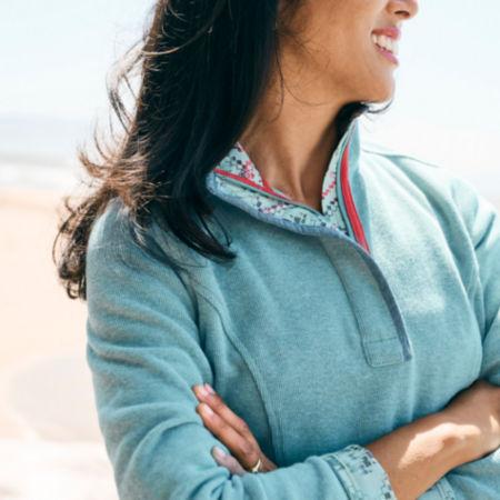 A close up of woman wearing signature sweatshirt