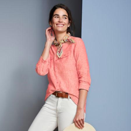 Woman smiling wearing a linen shirt