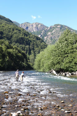 two anglers standing in a mountain river