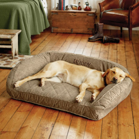 Yellow lab asleep on an Orvis dog bed