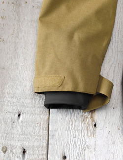 A close-up of the end of the sleeve, showing a velcro wrap and an elastic cuff within.