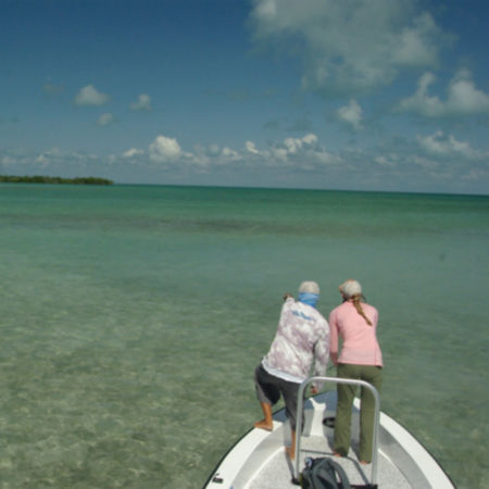 Two women fly fishing in Belize