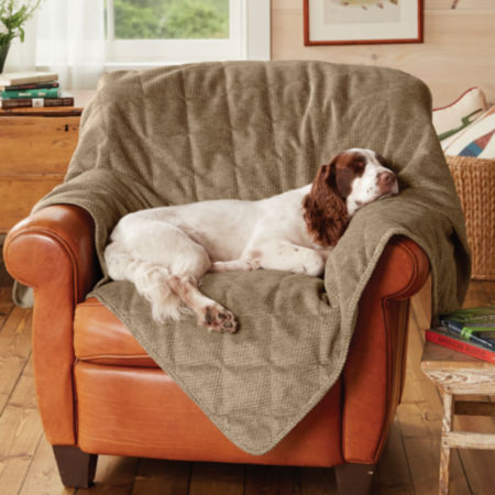 Dog asleep on a Grip-Tight Furniture Protector