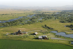 aerial view of ranch next to a river