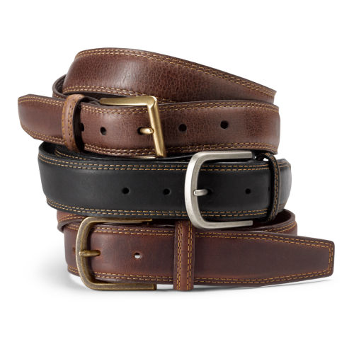 Three brown leather belts, coiled and stacked.