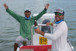 two people on a boat having fun