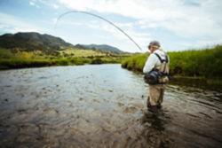 angler fishing in river
