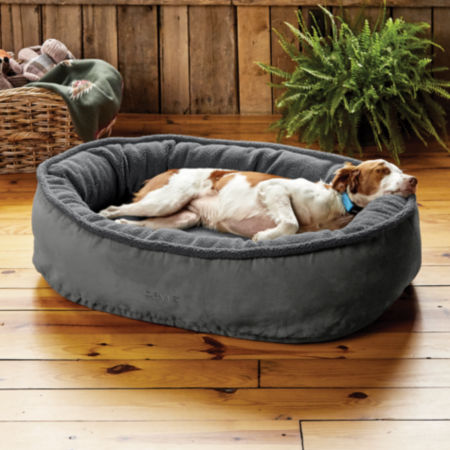 Dog laying on an Orvis Fleecelock Wraparound dog bed