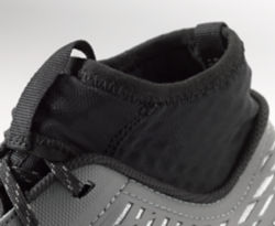 Close-up of the top of the shoe, showing the integrated sock