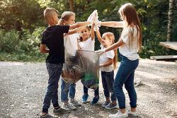 group of kids picking up trash