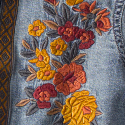 close up of embroidery on shirt