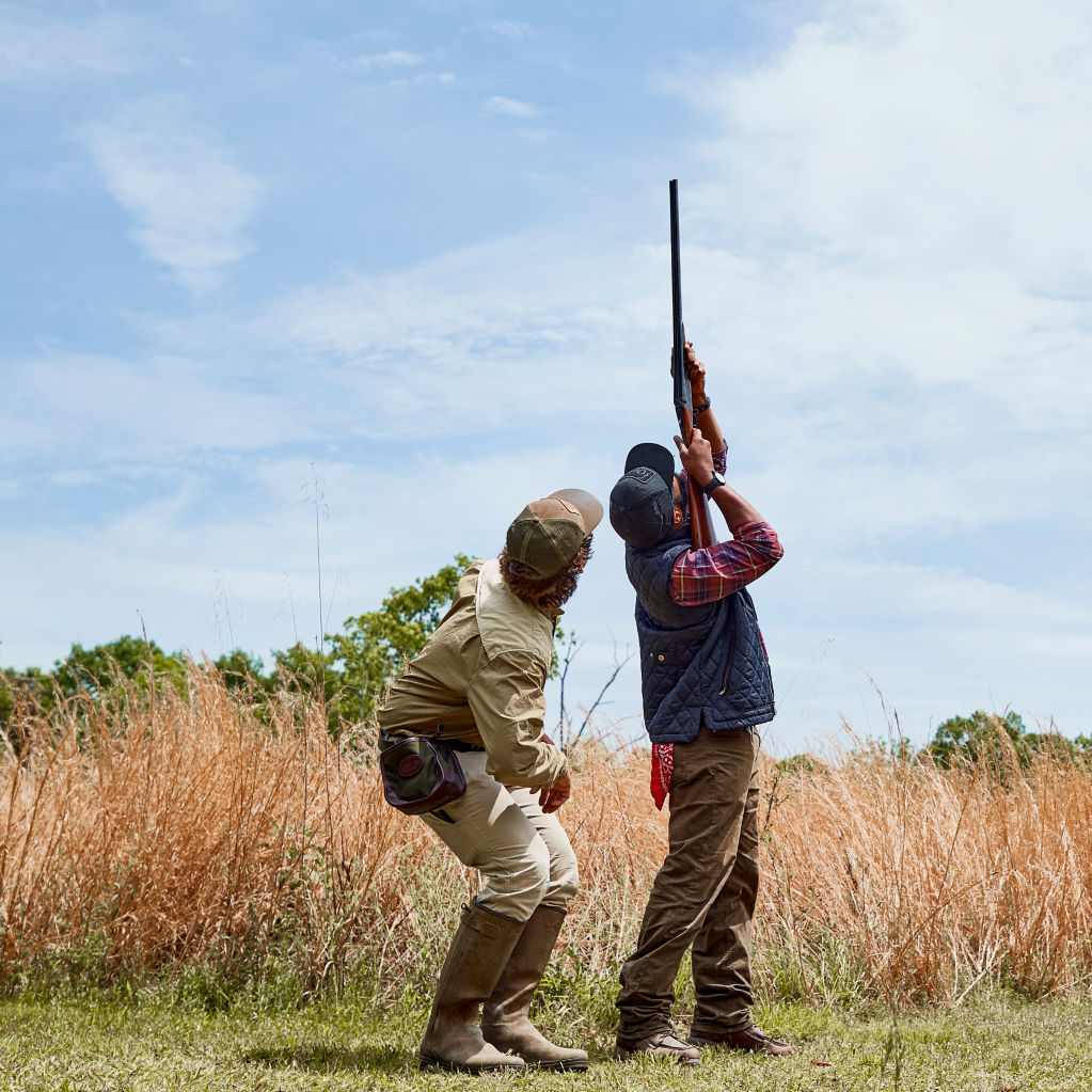 Instructor giving shooting lessons to a student