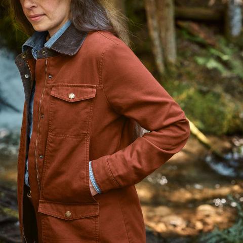 side view of Amanda wearing the Barn Coat
