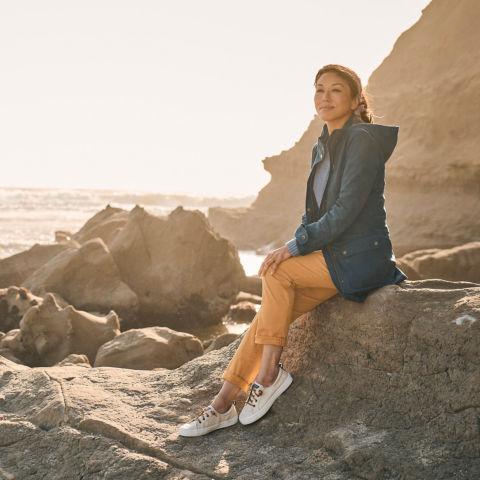 woman sitting on shoreline