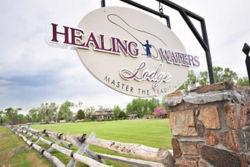 image of sign and gate for Healing Waters Lodge