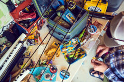 A cluttered workbench covered with fishing gear of all kinds.