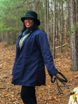 Woman on a walk in the woods with her dog