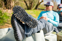 An angler takes a break and puts his feet up, showing the Michelin-designed outsole of the PRO wader boot.