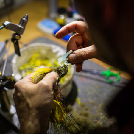Using a razor blade to fine-tune a freshly tied fly.