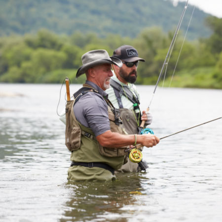 Instructor teaching a man how to fish