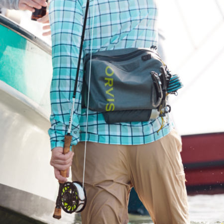 Man with blue fishing hip pack