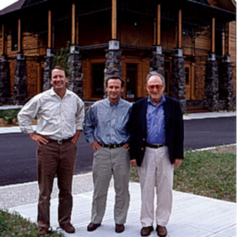 Leigh, Perk, and Dave standing outside the flagship store in Manchester, VT.