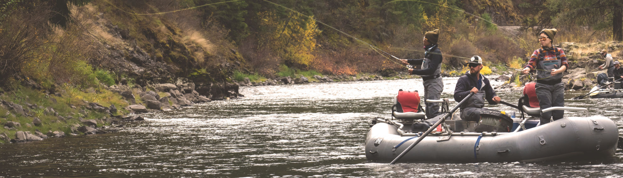 Two anglers cast from a raft on the Yamhill River in Oregon.