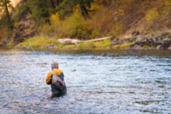 Man wading in a river