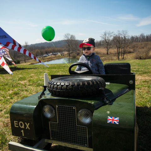 Child riding a toy Land Rover