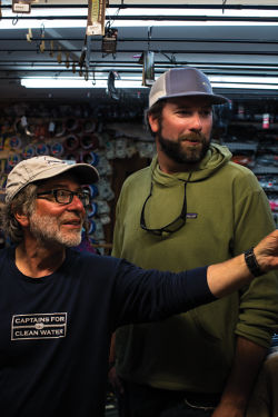 Tom shows something to Orvis instructor Pete Kutzer.