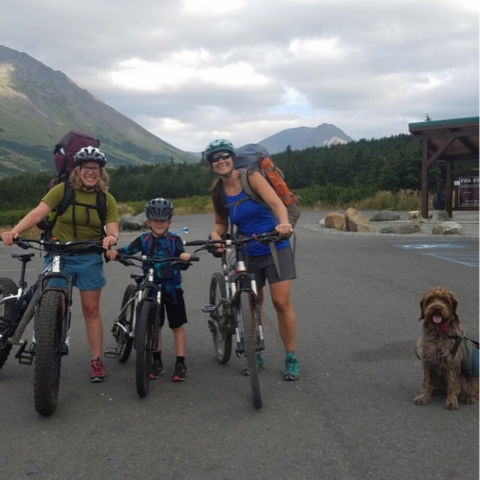 Nelli Williams with her son, friend, and mountain bikes.