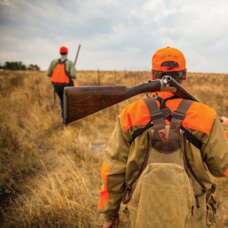 Bird hunters in a field