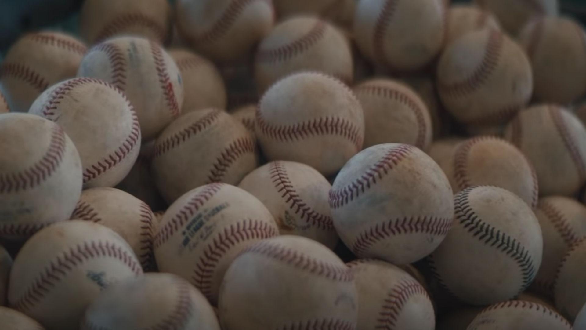 Off Season video image—a pile of baseballs.
