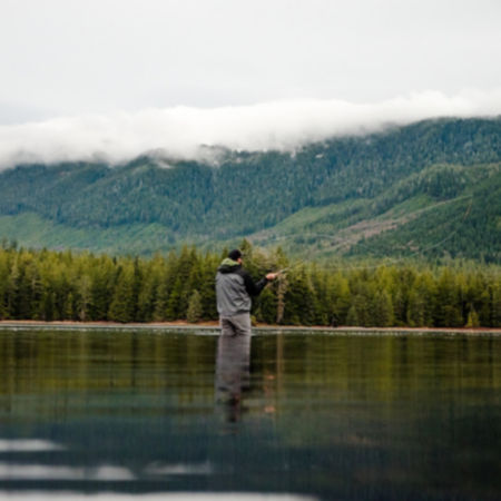 Fisherman two-handed casting in Alaska
