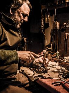 Orvis Gunsmith Jordan Smith at his workbench