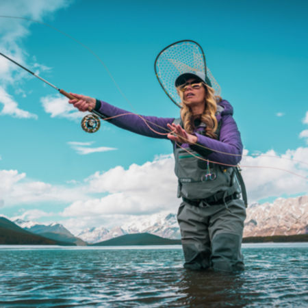 Woman casting a fly rod