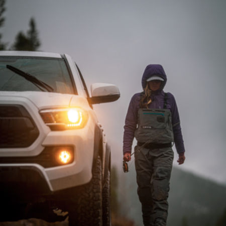 Woman walking next to a truck
