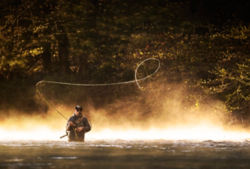Man casting a spey rod on a river