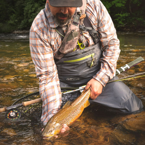 Man holding a large brown trout