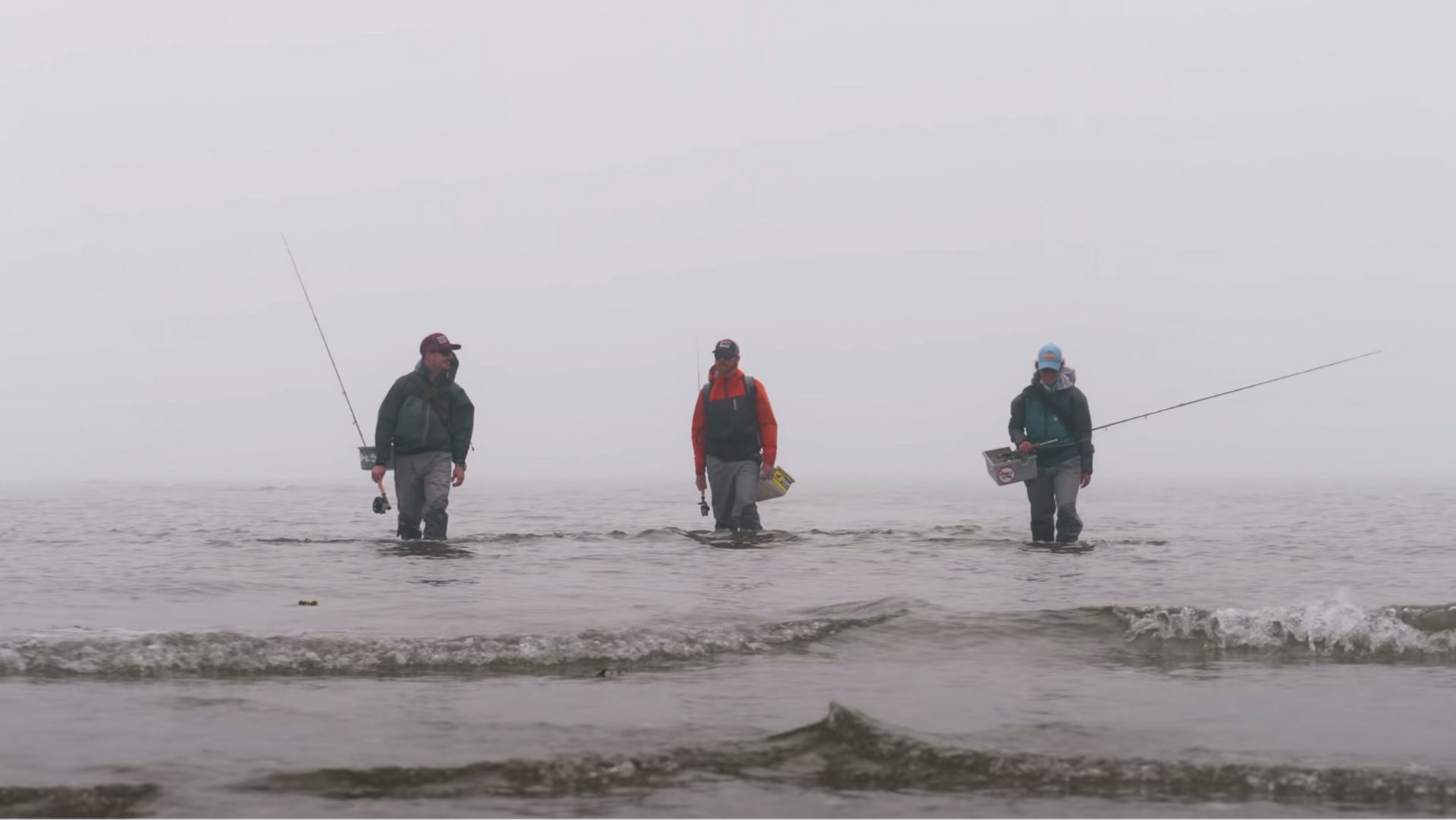 three anglers wading in water
