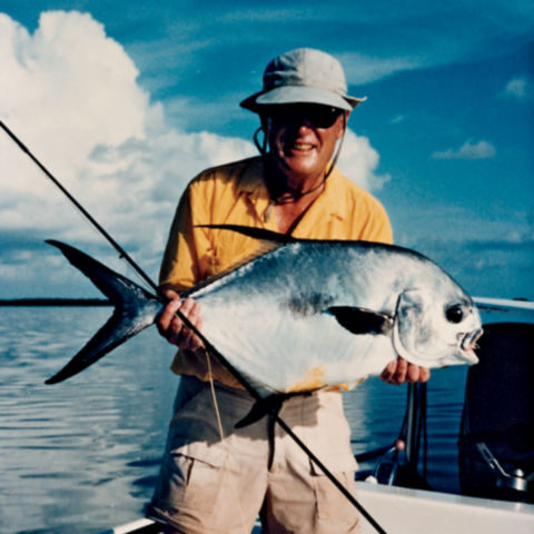 Leigh H Perkins holding a very large fish