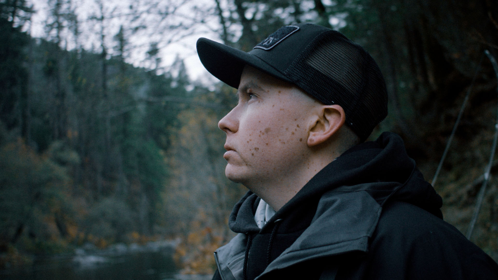 Profile picture of Paul next to a river.