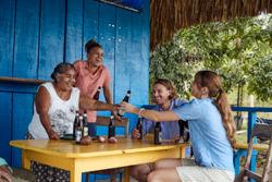 Tourists enjoying a roadside bar in Belize